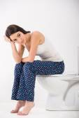 Woman in toilet — Stock Photo