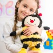 Little girl with toy bee — Stock Photo #71730141