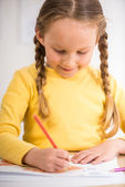 Girl drawing — Stock Photo