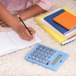 Mulatto girl doing homework — Stock Photo #72089929