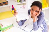 Schoolgirl showing test results — Stock Photo