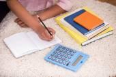 Mulatto girl doing homework — Stock Photo