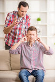 Father and son at home — Stock Photo