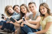 Students with gadgets — Stock Photo