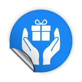 Gift in hands icon. — Stock Vector