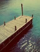 Pier on the river — Stockfoto
