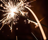 Sparkler on blurred background — Stock Photo