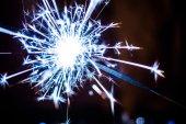 Sparkler on blurred background — Stock fotografie