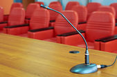 Microphone in front of empty chairs. — Stock Photo