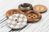 Buttons on wooden table — Fotografia Stock