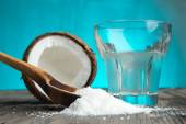 Coconut and glass with milk — Stock Photo