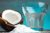 Coconut and glass with milk — Photo