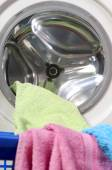 Washing machine with clothes — Stock Photo
