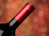 Bottle in red background — Stock Photo