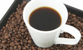 Brewed coffee and coffee beans — Stock Photo