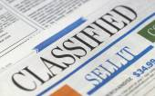 Classifieds section in newspapers - buy and sell — Stock Photo