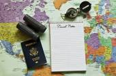 Map of the world with notepad, passport,compass and binoculars — Stockfoto