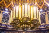 Beautiful mosaic design on ceiling . Ornaments on the walls and chandelier composition — Stock Photo