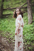 Beautiful young woman in the forest — Stock Photo