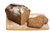 Brown bread on white background — Stock Photo