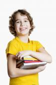 Boy is holding books — Foto Stock