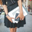 Businesswoman in the city with documents — Stock Photo #55201649