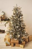 Beautiful holdiay decorated room with Christmas tree with present boxes under it — Stock Photo