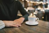 Hands of engaged couple in cafe with Young couple in cafe sittin — Stock Photo