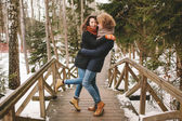 Curly hair hipster couple hugging in winter forest — Fotografia Stock