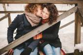 Young couple having fun outdoors in winter park — Fotografia Stock