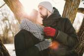 Hipster couple in winter park with hot tea from thermos — Stock Photo