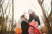 Hipster couple in winter park with hot tea thermos — Stock Photo