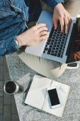 Smartphone, coffee tablet and laptop in man hands outdoors — Stock Photo