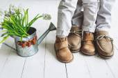 Legs of boy and man, in moccasins with flowers — Stock Photo