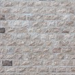 House wall faced with stone tiles — Stock Photo #68722985