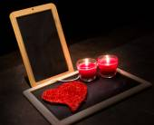 Candle , roses , a blackboard — Stock Photo
