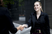 Two business women shaking hands — Stock Photo