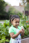 Young girl with flower in garden — Stock Photo
