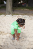 Small child on playground with sand — Photo