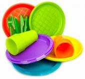 Disposable bright plastic dishes stacked on white — Stockfoto