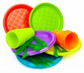 Disposable bright plastic kitchenware stacked on white — Foto Stock