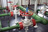 Pipeline valves in pump station — Stock Photo