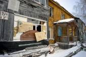 Old wooden house with boarded up Windows. — Stock Photo