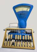 Scales and wooden abacus. — Stockfoto