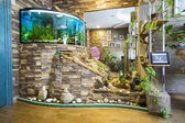 The living area of the apartment with aquarium — Stock Photo