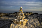 Pyramid of stones by the sea — Stock Photo