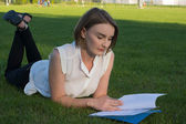 Girl in the park with documents — Stock fotografie