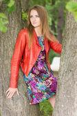 Beautiful blonde in summer park — Stock Photo