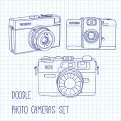 Set of hand drawn photo cameras. — Stock Vector