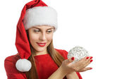 Woman in red winter hat holding decorative ball — Stock Photo